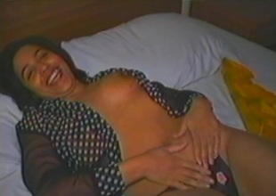 Fabulous brunette hair milf with natural tits masturbating with a vibrator close concerning