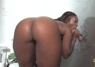 Glamorous gloomy with big tits giving big schlong handjob during the time that displaying her black butt