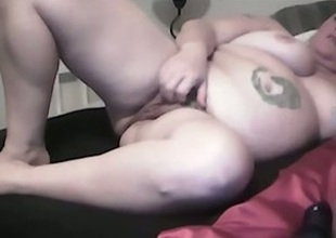 My fat tattooed wife toys her cunt to orgasm indoors