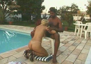 Dashing blonde has will not hear of twat licked wide of the pool before being screwed yon a large black cock