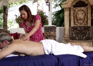 Brunette masseuse gives her gargantuan consumer special treatment
