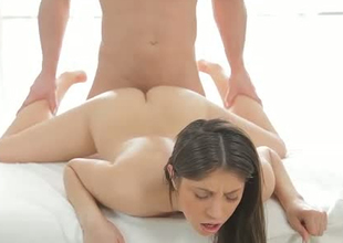 Submissive brunette bimbo screwed doggystyle on the massage directors