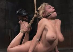 Busty blonde whore is confined up and stretched in S&m porn video