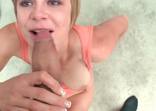 Pretty blonde with blue eyes is sucking a huge dig up