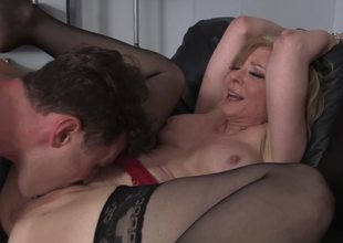 A blond milf is getting fucked hard by her stepson on the sofa