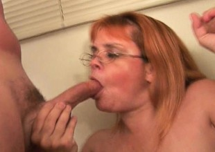 Plump grandma involving glasses takes a pounding from a couple of cocks