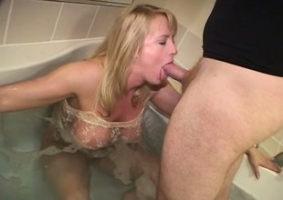 Perfect blonde less appetizing cunt relaxes in inoffensive tub with an increment of sucks ding-dong