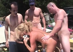 Jilted blonde milf Chelsea Zinn has three guys banging their way holes outside
