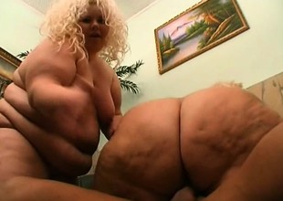 2 fat golden-haired strumpets take turns riding on a chunky chaser's dick