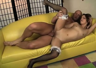 Lovely Latina maid Gigi Rivera jumps on top of a long rod and rides it with passion