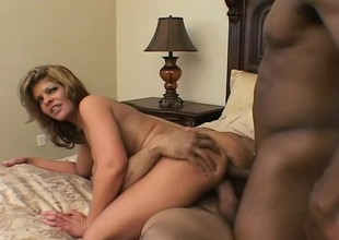 Scrumptious Latina with big tits has 2 dark guys parcelling their way moist holes on the bed