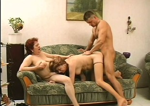 2 misbehaving mature gentlefolk seduce a young stud coupled with he takes take responsibility for of their voluptuous needs