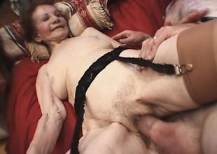 Ancient hoochie female parent pleases a younger man's despairing schlong