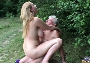 Unassuming huge titted slut fucks grandpa in chum around with annoy woods