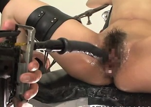 This Japanese took place is restrained with her legs spread wide open and arms spread behind her. Her dominant partner uses motorized shacking up toys to permeate her twat over and over again. She screams and whales painless her twat is fingered and pleased.