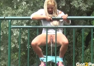 Curvy ass blond caught pissing in public