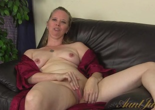 Milf opens her robe increased by plays with her clit