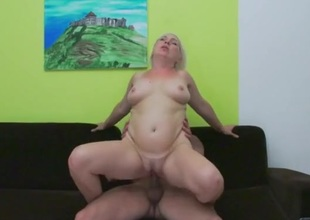 Bleach blonde older lady laid from behind