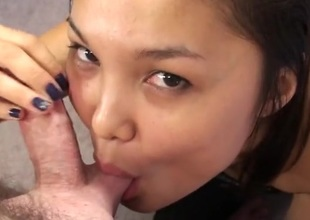 Cute Asian on her knees sucks his dick sensually