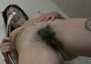Cutie washes her hairy armpits and pussy