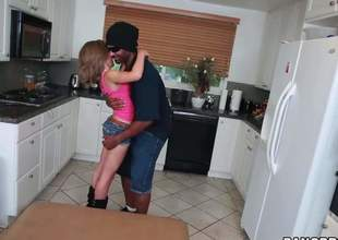 Petite ivory girl Natasha White in pink brassiere and hot shorts drops on her knees in a catch middle of a catch kitchen and acquires her mouth lip with black monster cock. He stretches her mouth to a catch max with his large pole