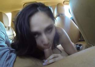Nice brunette girl with titties out wraps their way sexy lips around men hard dick with regard to a car. Then bad girl spreads their way legs. She makes men sexual intercourse fantasies come to life with regard to the backseat