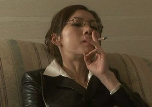 Smoking Japanese girl with glasses sucks their way boss's cock