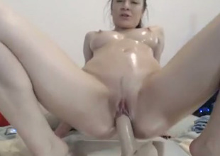 Huge tittied floozy rides her suction cup dildo disposed to a trull possessed