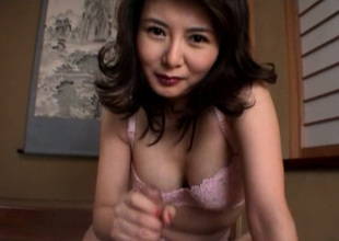 Cute buxom and horny Japanese MILF jacks off dick with ecstasy mainly the floor