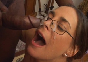Appealing pornstar in glasses giving big cock wild blowjob in interracial shoot