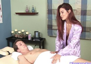 Redheaded massage babe gives his except for a great blowjob