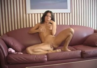 Tattooed solo model drives a monster dildo up her anal hardcore