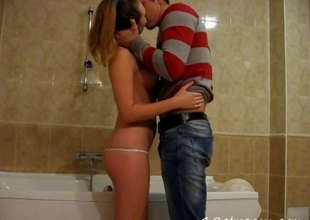 Charming teen alongside a tatting sneaks her boyfriend to the bathroom for a hardcore pussy drilling session