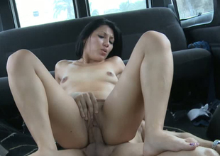 Sultry bitch riding hard ramrod out of reach of top in a van