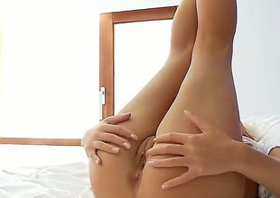 Blonde Megana with shaved muff is also horny to stop rubbing her muff