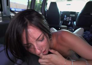 A brunette amateur is getting cumshot in the back of a car
