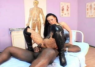 A horny latina girl in fishnets takes a black dick up her irritant