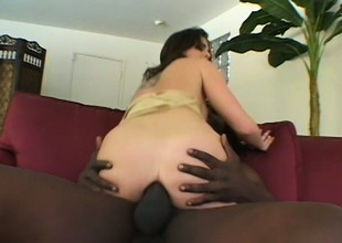 Brunette coed with a bubble butt receives shafted by a dark tool