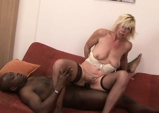 Sassy blonde MILF in stockings bends over for some big black penis