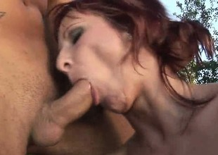 Skinny redheaded cougar screams while being pounded outdoors