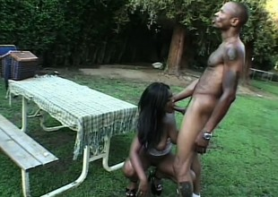 Domineer caramel girl Shawna passionately bounces on a huge menacing rod in the backyard