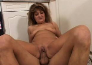 A feisty MILF is on the hunt of hung young dudes to bone her twat