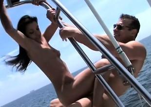 Striking juvenile brunette Alicia Angel enjoys a hard pounding on a boat