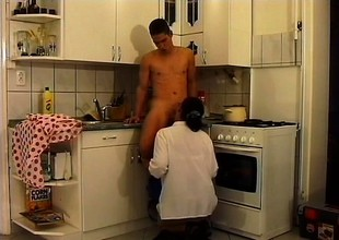 Good-looking mature babe in glasses gets wild fucking in kitchen
