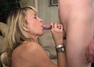 Downcast experienced MILF Kari gets it on with a young college guy