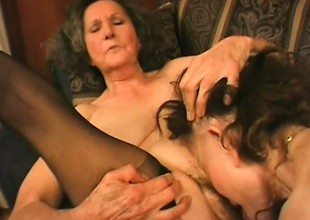 A handful of old horny grannies toy with each other's pussies with vibes