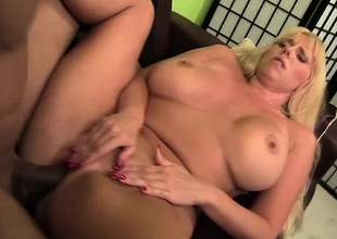 Blonde bimbo with massive fake tits gets team-fucked on a difficulty couch