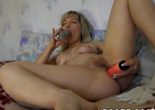 Horny, golden-haired MILF fingers and toys her pussy and aggravation untill she cums