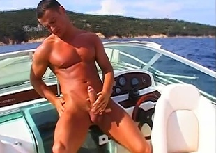 Fred Goldsmith has found some time alone, in this 6 minute outdoor masturbation quickie.  The sky is clear, the water is bright, the air is thick and warm... and Fred is sweating it out, with a boner that won't rest!  This guy leans back in the cabin of his muffler