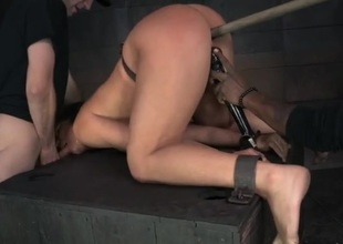 BDSM depending girl fucked from bet on a support in the dungeon